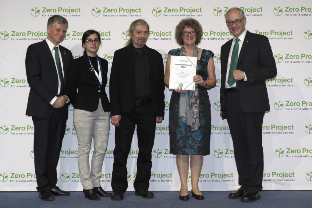 Sonokids' Phia Damsma and John Norgaard with the award certificate